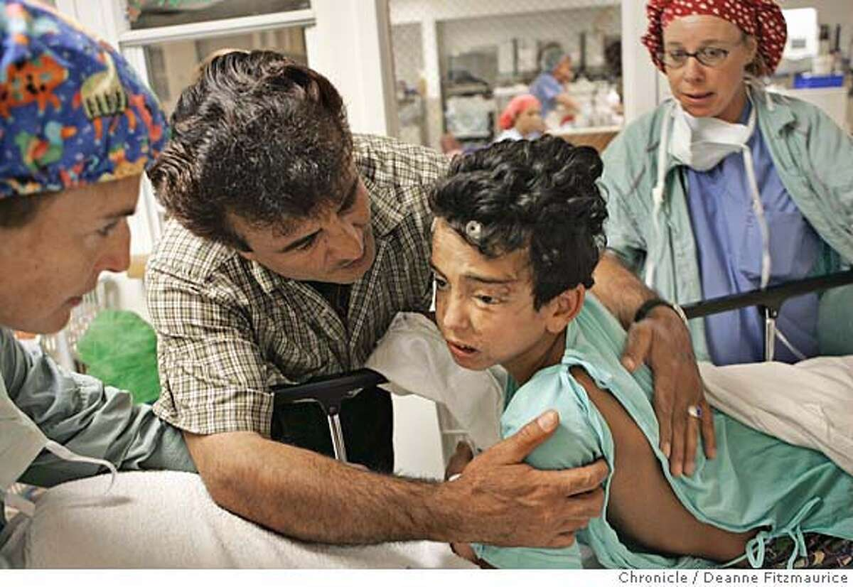 saleh_146_df.JPG Raheem Khalaf comforts his son, Saleh, 10, as he is being wheeled in by (left) anesthesiologist Gail Savarese, MD and (right) Jeanine Malone, RN, for brain surgery at Children's Hospital Oakland to remove a piece of shrapnel that has been lodged in his brain since an explosion near his home in Iraq. Saleh lives in Oakland now with his family. San Francisco Chronicle/ Deanne Fitzmaurice