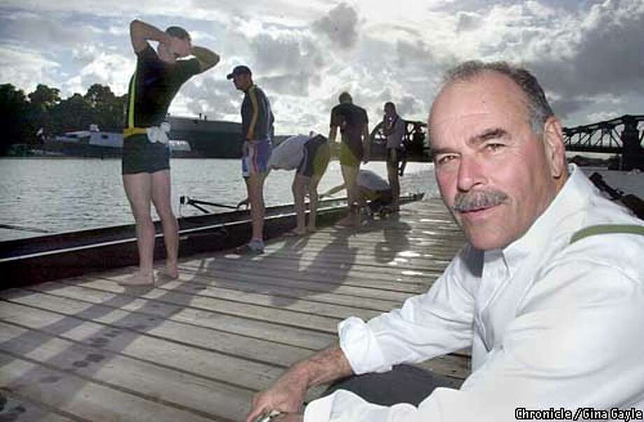 Steve Gladstone, Cal Altheltic Director and the Cal Crew coach with the top eight (varsity) and JV rowers during a practice in the Oakland Estuary. 4/29/03 in Oakland. GINA GAYLE / The Chronicle Photo: GINA GAYLE