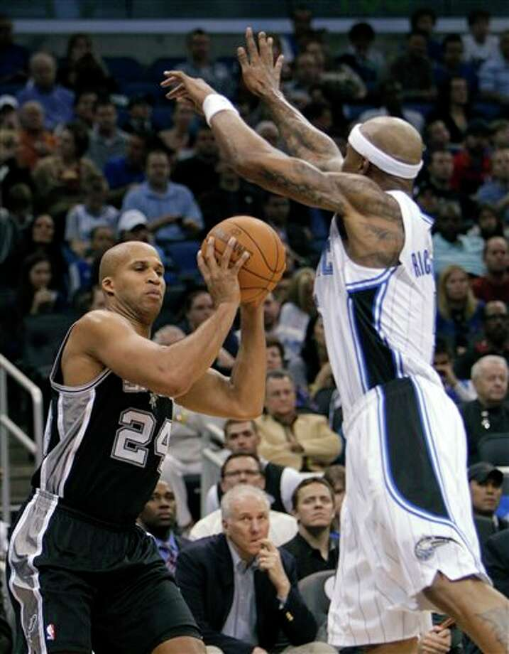 San Antonio Spurs' Richard Jefferson (24) pump-fakes and is fouled by Orlando Magic's Quentin Richardson during the first half of an NBA basketball game Wednesday, Jan. 18, 2012, in Orlando, Fla. (AP Photo/John Raoux) Photo: Associated Press