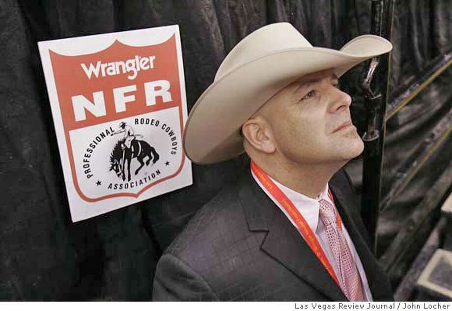PRCA Commissioner Troy Ellerman watches the scoreboard at the National Finals Rodeo in Las Vegas Friday, Dec. 9, 2005.. (John Locher/LAS VEGAS REVIEW JOURNAL) d=Sports Photo: John Locher/Las Vegas Review Jou