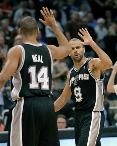 After sinking a 3-point shot in the closing seconds of overtime, San Antonio Spurs' Gary Neal (14) gets a high-five from teammate Tony Parker (9), of France, in an NBA basketball game against the Orlando Magic, Wednesday, Jan. 18, 2012, in Orlando, Fla. San Antonio won 85-83. (AP Photo/John Raoux) Photo: Associated Press