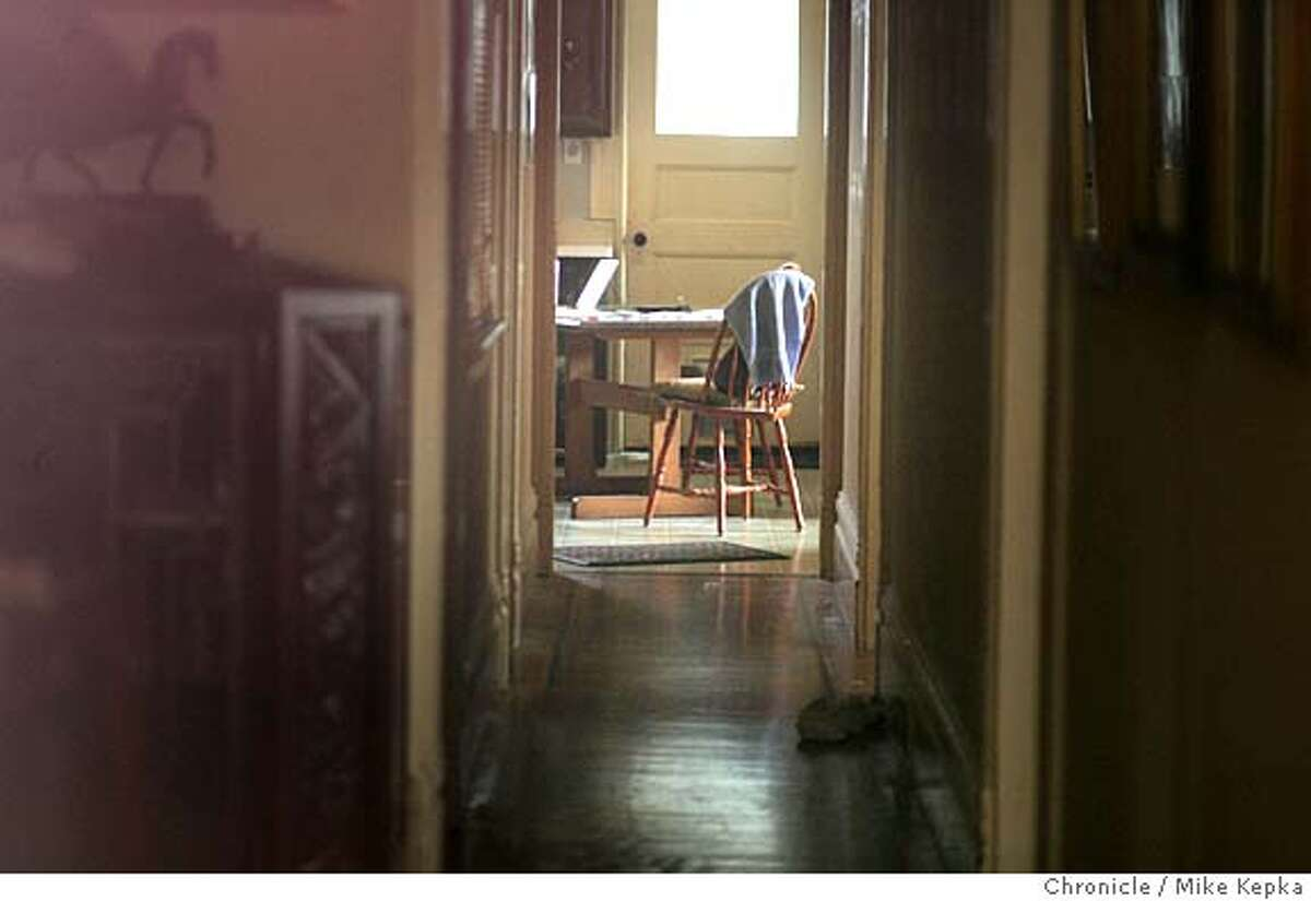 wil037_mkA.JPG A lonely chair sits inside Wilson Franklin's home two week after he was found dead inside his San Francisco home. Mail carrier, Janet Recabarren knew something was wrong when she hadn't seen 80-year-old Wilson Franklin's truck move in days. Franklin was a regular on her hilly Noe Valley route, 7/28/05 Mike Kepka / The Chronicle MANDATORY CREDIT FOR PHOTOG AND SF CHRONICLE/ -MAGS OUT