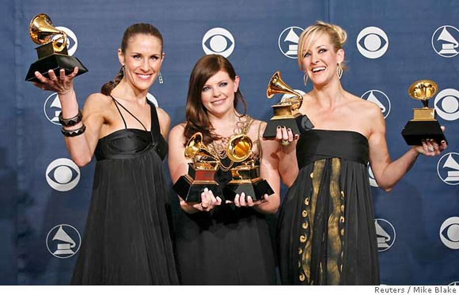 "The Dixie Chicks (L-R) Emily Robison, Natalie Maines and Martie Maguire pose with their Grammys at the 49th Annual Grammy Awards in Los Angeles February 11, 2007. The group won the Record of The Year, Song of the Year and Best Country Performance by a Duo or Group with Vocal for ""Not Ready to Make Nice""; and Best Country Album and Album of the Year for ""Taking The Long Way"". REUTERS/Mike Blake (UNITED STATES) Photo: MIKE BLAKE"