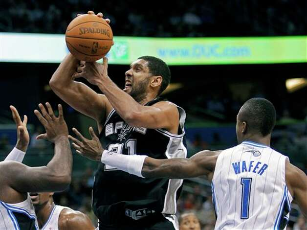 San Antonio Spurs' Tim Duncan loses his grip on the ball as he is fouled by Orlando Magic's Von Wafer (1) during the first half of an NBA basketball game Wednesday, Jan. 18, 2012, in Orlando, Fla. (AP Photo/John Raoux) Photo: Associated Press