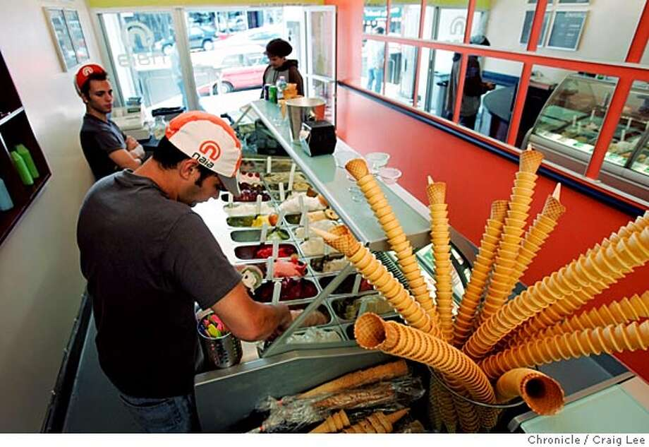 WHATS10_044_cl.JPG  For What's New column. Photo of Tom Cusumano scooping out some gelato in the foreground. Bobby Bryce in the background left. Trend story on new gelaterias opening up all over the place. This one, Gelateria Naia at 451 Castro street in San Francisco. It started in Berkeley and they also have a location in Walnut Creek.  Event on 8/8/05 in San Francisco. Craig Lee / The Chronicle MANDATORY CREDIT FOR PHOTOG AND SF CHRONICLE/ -MAGS OUT Photo: Craig Lee