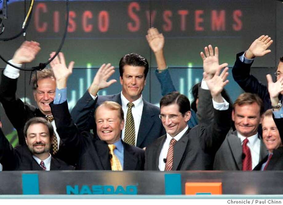 "cisco11_101_pc.jpg  Cisco Systems CEO John Chambers (second from left) ""virtually"" opened the NASDAQ trading day at corporate headquarters on 8/10/05 in San Jose, Calif. NASDAQ president and CEO Bob Greifeld (third from left) and over 2,000 employees were on hand for the ceremony which marked the first time in NASDAQ history that the opening occurred outside of New York City.  PAUL CHINN/The Chronicle MANDATORY CREDIT FOR PHOTOG AND S.F. CHRONICLE/ - MAGS OUT Photo: PAUL CHINN"