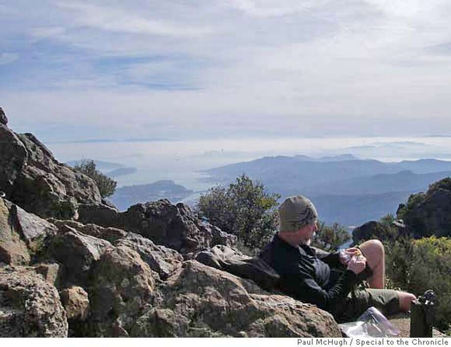 Seattle hiker Greg Gorman enjoys a lunch break atop Mt. Tamalpais after hiking up from Muir Woods. CREDIT: Paul McHugh FOR: Outdoors, sports, 2/15/2007 Photo: Paul McHugh
