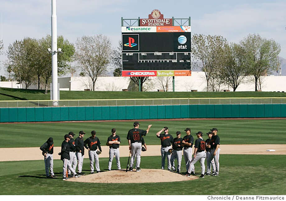 New manager Bruce Bochy stands on the pitchers mound and talks to the players during the first workout of the season. San Francisco pitchers and catchers reported for their first workout today at Scottsdale Stadium for Spring Training. Photographed in Scottsdale on 2/15/07. Chronicle Photo / Deanne Fitzmaurice Photo: Deanne Fitzmaurice