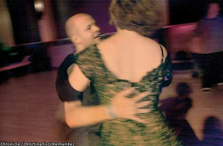 Brian McDaniel, of SF, swings around Liz Angoff, of Oakland, during a night of swing dancing. SWEETS BALLROOM has been restored and hosts a swing dance night. . Shot on 5/10/03 in Oakland. CHRISTINA KOCI HERNANDEZ / The Chronicle Photo: CHRISTINA KOCI HERNANDEZ
