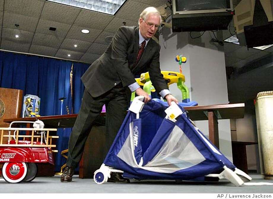 Consumer Product Safety Commission (CPSC) Chairman Hal Stratton demonstrates a collapsing playpen during the CPSC's annual toy safety news conference, Tuesday, Nov. 26, 2002 in Washington. Stratton said holiday shoppers who bought childrens products earlier in the year may have purchased potentially dangerous items that have since been recalled. He urged shoppers to check recall lists.(AP Photo/Lawrence Jackson)  Ran on: 07-23-2006  Hal Stratton, former chairman of the Consumer Product Safety Commission, has switched sides. CAT Photo: LAWRENCE JACKSON