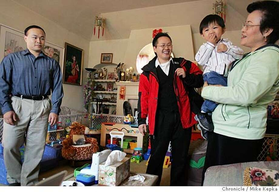 James Hwang says goodbye to his brother Danny Hwang (left) nephew Matthew Hwang and mother June Hwang before leaving for work.  James Hwang (middle is an adult who lives in the house he grew up in with his mother, brother, sister-in-law and nephew in the Sunset district. 7/20/05 Mike Kepka / The Chronicle Photo: Mike Kepka