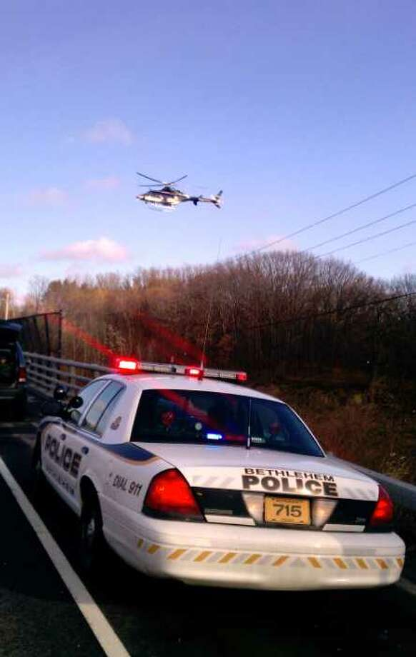 A police helicopter flies overhead as authorities hunt for a Chatham man they said jumped off of the Normans Kill Bridge on Wednesday, Jan. 18, 2012. His body was found later in the day. (TOM HEFFERNAN Sr. / SPECIAL TO THE TIMES UNION)