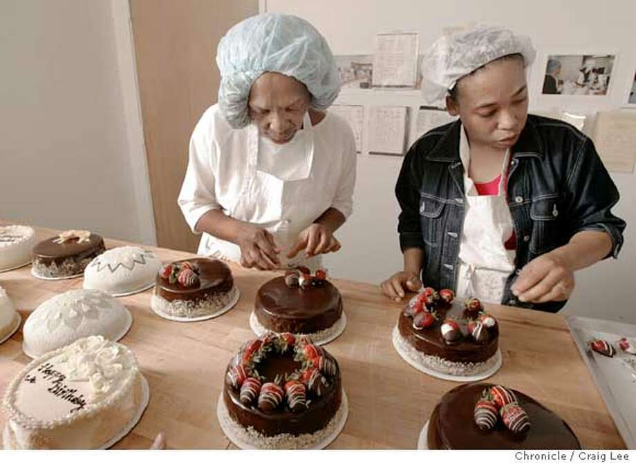 Debra Jones in the Bread Project class, a four-year-old Berkeley program that trains hard-to-place people. She is a 47-year-old African-American single mother of two from Santa Cruz, nearing her six-month rehab program in Oakland. Photo of Debra Jones (left) and Tiffany Thomas (right) decorating cakes in the class.  Event on 5/10/05 in Berkeley. Craig Lee / The Chronicle Photo: Craig Lee