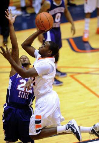 UTSA's Kannon Burrage drives to the hoop as Louis Ellis (22) of Northwestern State defends during Southland Conference basketball action at the UTSA Convocation Center on Wednesday, Jan. 18, 2012. BILLY CALZADA / San Antonio Express-News 