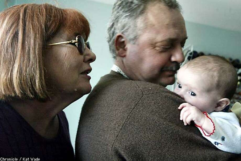 Ilona Meszaros and her husband, Istvan Meszaros, admire 3-month-old daughter Monica. Chronicle photo by Kat Wade