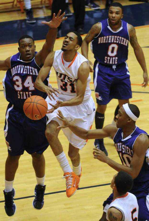 Melvin Johnson III of UTSA (31) loses the ball as he drives by Gary Roberson of Northwestern State during Southland Conference basketball action at the UTSA Convocation Center on Wednesday, Jan. 18, 2012. BILLY CALZADA / San Antonio Express-News 