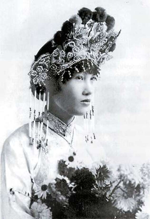"""A Chinese American bride in Boise, Idaho, sports a traditional bridal costume, though the year is 1927. Photo courtesy of """"The Chinese in America''"""