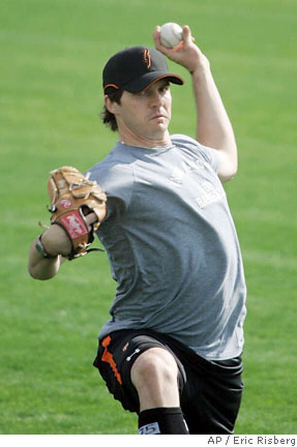 San Francisco Giants' new starting pitcher Barry Zito loosens up his arm while throwing with teammate Steve Kline during a spring training baseball workout at Scottsdale Stadium in Scottsdale, Ariz., Wednesday, Feb. 14, 2007. Zito played last season for the Oakland Athletics.(AP Photo/Eric Risberg) Photo: Eric Risberg