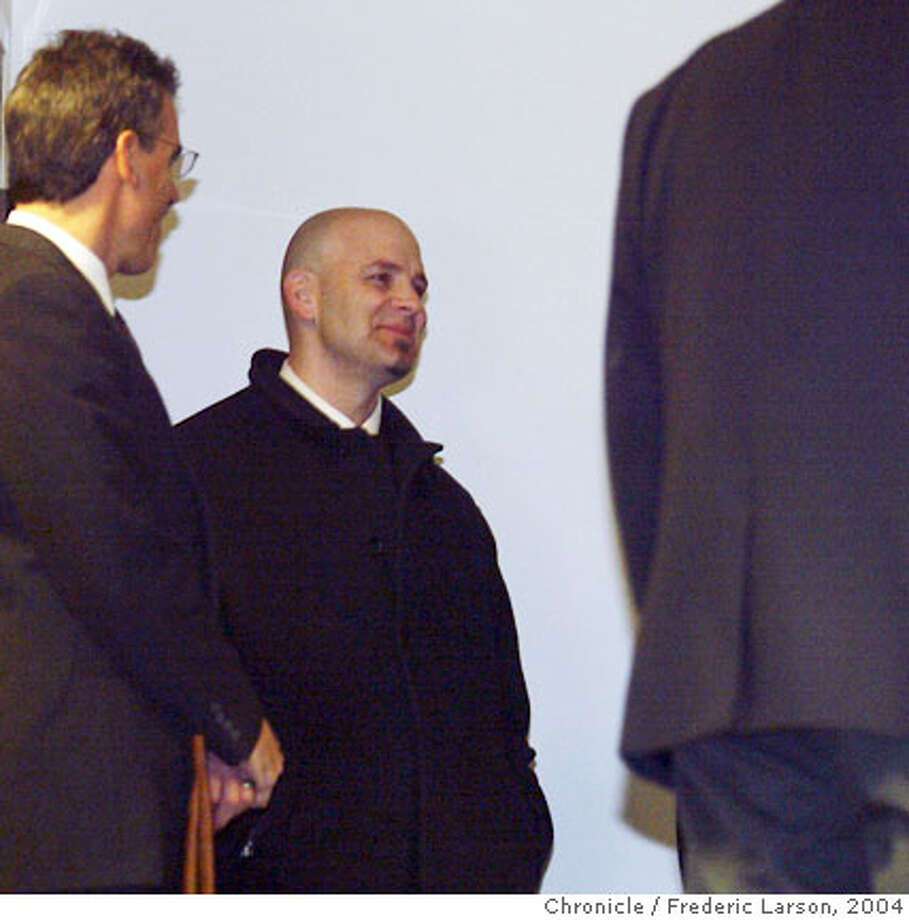 DO NOT USE UNTIL IDENTITIY IS CONFIRMED!!!! - RR ; Troy Ellerman (center) waits at the San Francisco Federal Building prior to his client, Victor Conte, pleading innocent before Federal Magistrate Judge Maria-Elena James. Conte was released on his own recognizance, pending a hearing Feb. 27 to set bail. Government lawyers said they will seek a $100,000 bond, and the four defendants have until the hearing to prove they can provide that amount. According to the government's indictment, the four men were meticulous in their planning. Federal prosecutors said they gave their drugs code names, carefully worded e-mails to avoid detection and even provided athletes with cover stories if caught. But they were less careful when it came to garbage, prosecutors said. Important elements of the government's case -- appreciative notes from athletes, canceled checks, empty pill sheets -- were gleaned from the trash behind the Bay Area Laboratory Co-Operative, or BALCO, that is the center of the probe. City:� 2/13/04, in San Francisco, CA. Frederic Larson/The Chronicle; Photo: Frederic Larson
