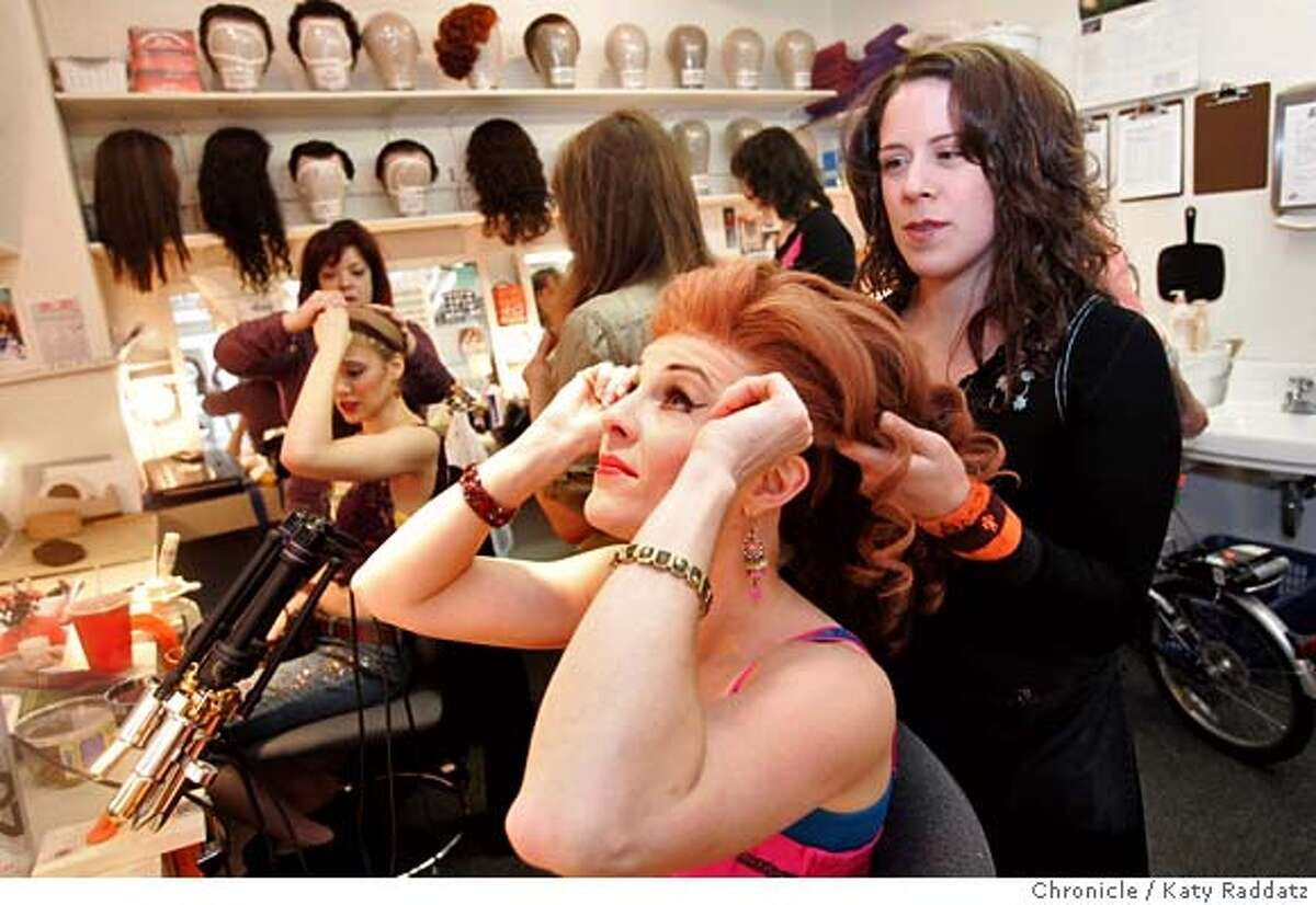 """JERSEYGIRLS_018_RAD.jpg SHOWN: Janelle Leone, assistant hair supervisor, has just put Sandra Denise's wig on Sandra's head, and is doing the final fluffing and adjusting. The story is about the women who star in """"Jersey Boys"""" now playing at the Curran Theater in San Francisco--the women play, among them, 46 parts, going through numerous costume changes. These photos were made on Wednesday, Jan. 24, 2007, in San Francisco, CA. (Katy Raddatz/SF CHRONICLE) **Sandra Denise, Janelle Leone Mandatory credit for the photographer and the San Francisco Chronicle. No sales; mags out."""