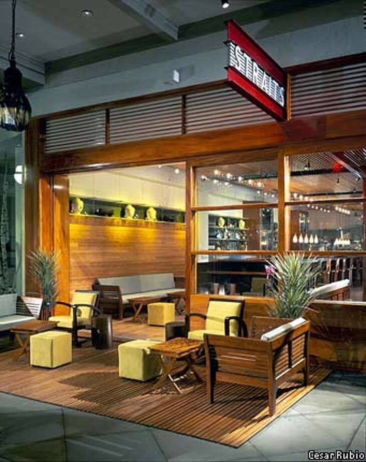Straits restaurant sets Indonesian furniture out on the sidewalk to evoke Singapore in Santana Row. Photo by Cesar Rubio
