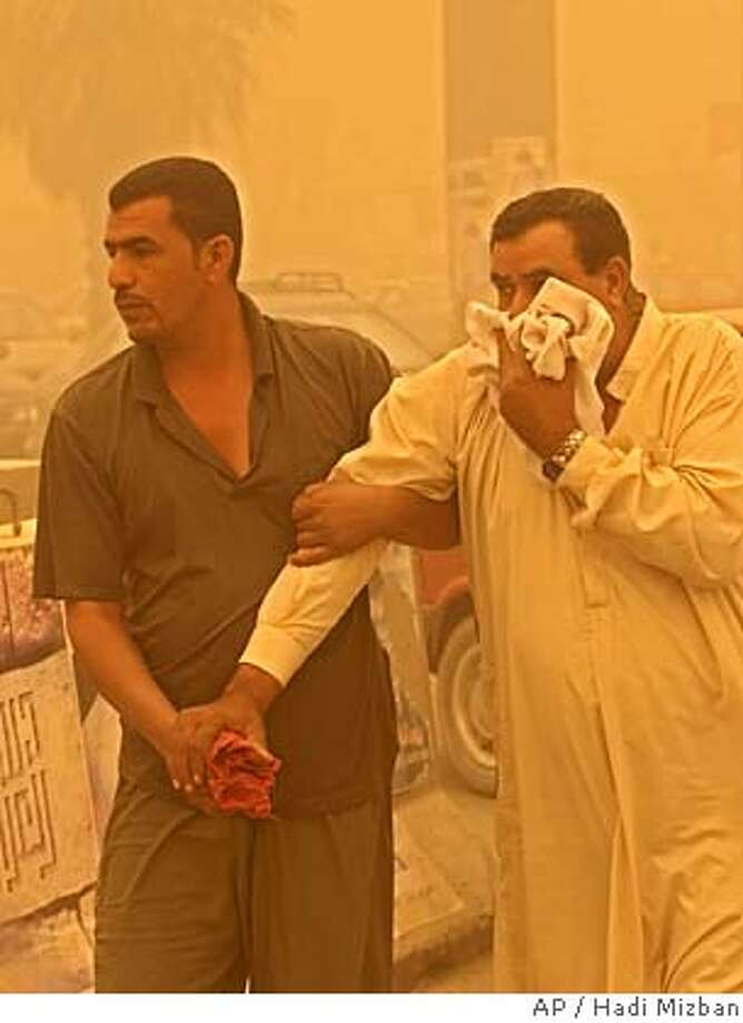 Iraqis having trouble breathing during a massive sandstorm seek treatment at the Yarmouk hospital, Monday, Aug. 8, 2005, in Baghdad, Iraq. Occasional sandstorms create breathing difficulties and reduce visibility to meters causing airports to close and road traffic to reduce to a crawl. (AP Photo/Hadi Mizban) ** ORIGINAL TONING ** Photo: HADI MIZBAN