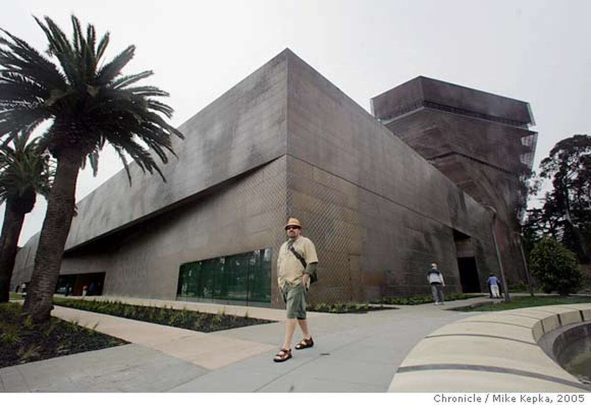 Ted Woodward, of San Francisco, walks past the new De Young museum.