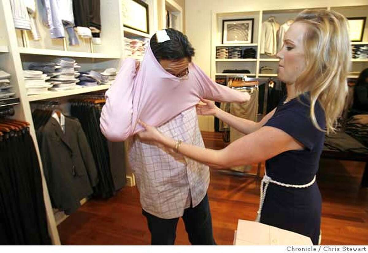 """dating14_050_cs.jpg Marv Su, a 44-year-old vice president of marketing at Vindicia Inc. in San Mateo has hired professional matchmaker Amy Andersen of Linx Dating LLC. One of the """"concierge"""" services that Andersen offers is grooming and clothing advice, which she offers Marv at Banana Republic at the Hillsdale Shopping in San Mateo. Photographed February 13, 2007. Chris Stewart / The Chronicle MANDATORY CREDIT FOR PHOTOG AND SF CHRONICLE/NO SALES-MAGS OUT"""