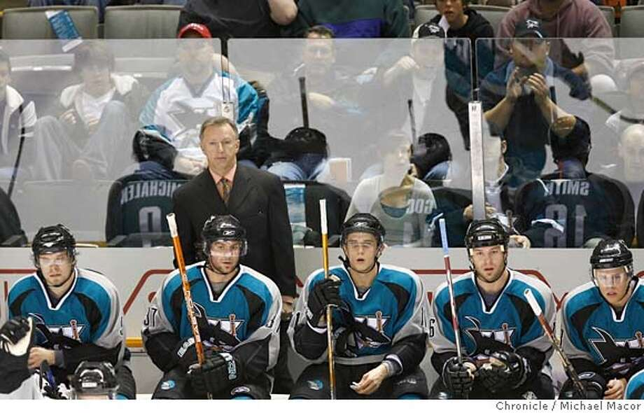 sharks_160_mac.jpg Sharks head coach Ron Wilson keeps an eye on things from the bench. NHL Hockey San Jose Sharks vs. Anaheim Mighty Ducks, Event in, San Jose, Ca, on 12/26/06. Photo by: Michael Macor/ San Francisco Chronicle Mandatory credit for Photographer and San Francisco Chronicle No sales/ Magazines Out Photo: Michael Macor