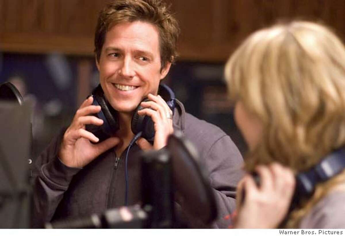 HUGH GRANT stars as Alex Fletcher in Warner Bros. Pictures� and Village Roadshow Pictures� romantic comedy �Music and Lyrics,� distributed by Warner Bros. Pictures. The film also stars Drew Barrymore.PHOTOGRAPHS TO BE USED SOLELY FOR ADVERTISING, PROMOTION, PUBLICITY OR REVIEWS OF THIS SPECIFIC MOTION PICTURE AND TO REMAIN THE PROPERTY OF THE STUDIO.
