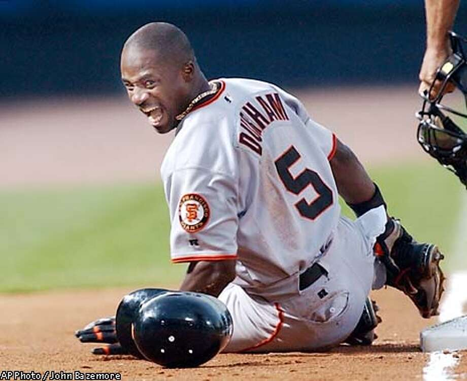 San Francisco Giants' Ray Durham reacts after being injuried trying for third on a double during the fifth inning against the Atlanta Bravesi n Atlanta, Saturday, May, 10, 2003. Durham left the game. (AP Photo/John Bazemore) Photo: JOHN BAZEMORE