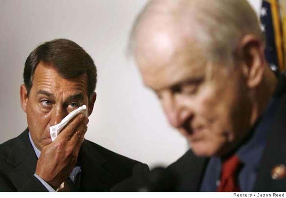 U.S. House Minority leader John Boehner (L)(R-OH) wipes tears from his face as he listens to fellow rep. Sam Johnson (R-TX) speak about his time as a prisoner during in the Vietnam war, following a Republican conference meeting on Capitol Hill in Washington February 13, 2007. Before the House begins debate on an Iraq war resolution Tuesday, Johnson said 34 years ago when he was a prisoner of war, opposition to the conflict from within America hurt morale of troops on the ground in Vietnam, just as the current resolution may hurt the morale of troops currently in Iraq. REUTERS/Jason Reed (UNITED STATES) 0 Photo: JASON REED
