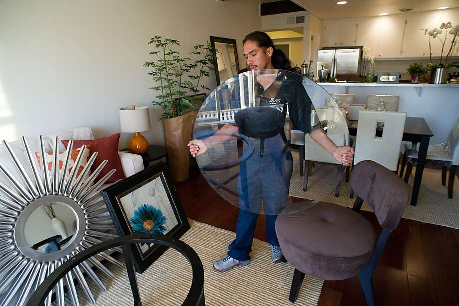 Bella Casa Home Staging worker Manuel Sanchez moves a glass table top at a condo for sale in San Francisco, California, U.S., on Tuesday, Jan. 3, 2012. The National Association of Realtors is scheduled to release existing home sales data on Jan. 20. Photographer: David Paul Morris/Bloomberg *** Local Caption *** Manuel Sanchez Photo: David Paul Morris, Bloomberg