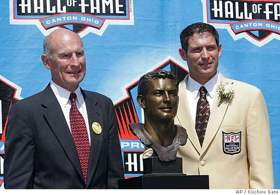 """Former San Francisco 49ers quarterback Steve Young, right, stands next to his bust with his father LeGrande """"Grit"""" Young Sunday, Aug. 7, 2005 at Pro Football Hall of Fame in Canton, Ohio. (AP Photo/Kiichiro Sato) Photo: KIICHIRO SATO"""