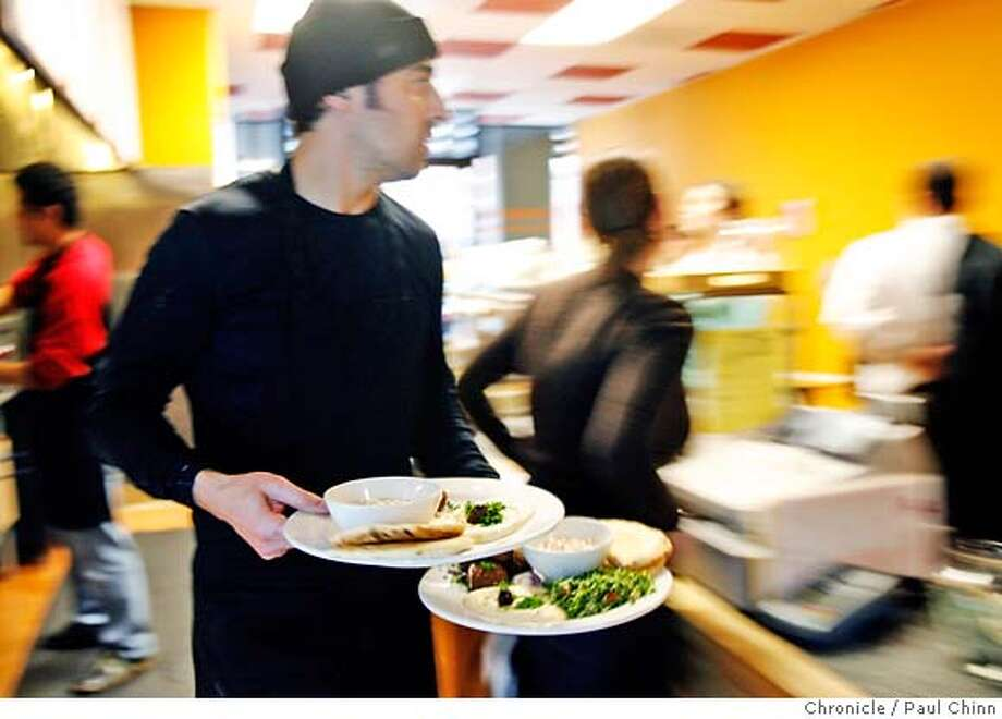Ziad Tinawi delivers meals to lunchtime diners at Saffron 685 Mediterranean restaurant in San Francisco, Calif. on Thursday, Feb. 8, 2007.  PAUL CHINN/The Chronicle  **Ziad Tinawi MANDATORY CREDIT FOR PHOTOGRAPHER AND S.F. CHRONICLE/NO SALES - MAGS OUT Photo: PAUL CHINN
