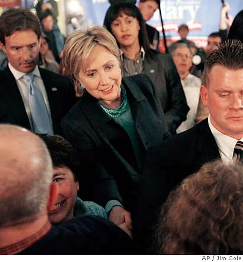 U.S. Sen. Hillary Clinton, D-N.Y., shakes hands following a town meeting in Keene, N.H., Sunday, Feb. 11, 2007. More than 6,000 people saw Clinton on her two-day, five city campaign trip to the nation's earliest presidential primary state. (AP Photo/Jim Cole) Photo: Jim Cole