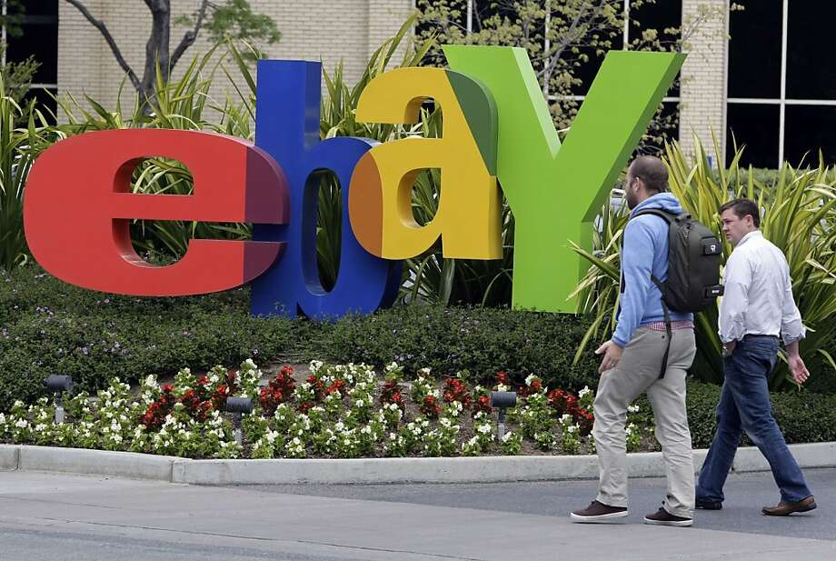 FILE - In this April 22, 2011 file photo, two pedestrians pass eBay headquarters in San Jose, Calif. EBay Inc. reports quarterly financial results Wednesday, Jan. 18, 2012, after the market close. (AP Photo/Paul Sakuma, File) Photo: Paul Sakuma, Associated Press