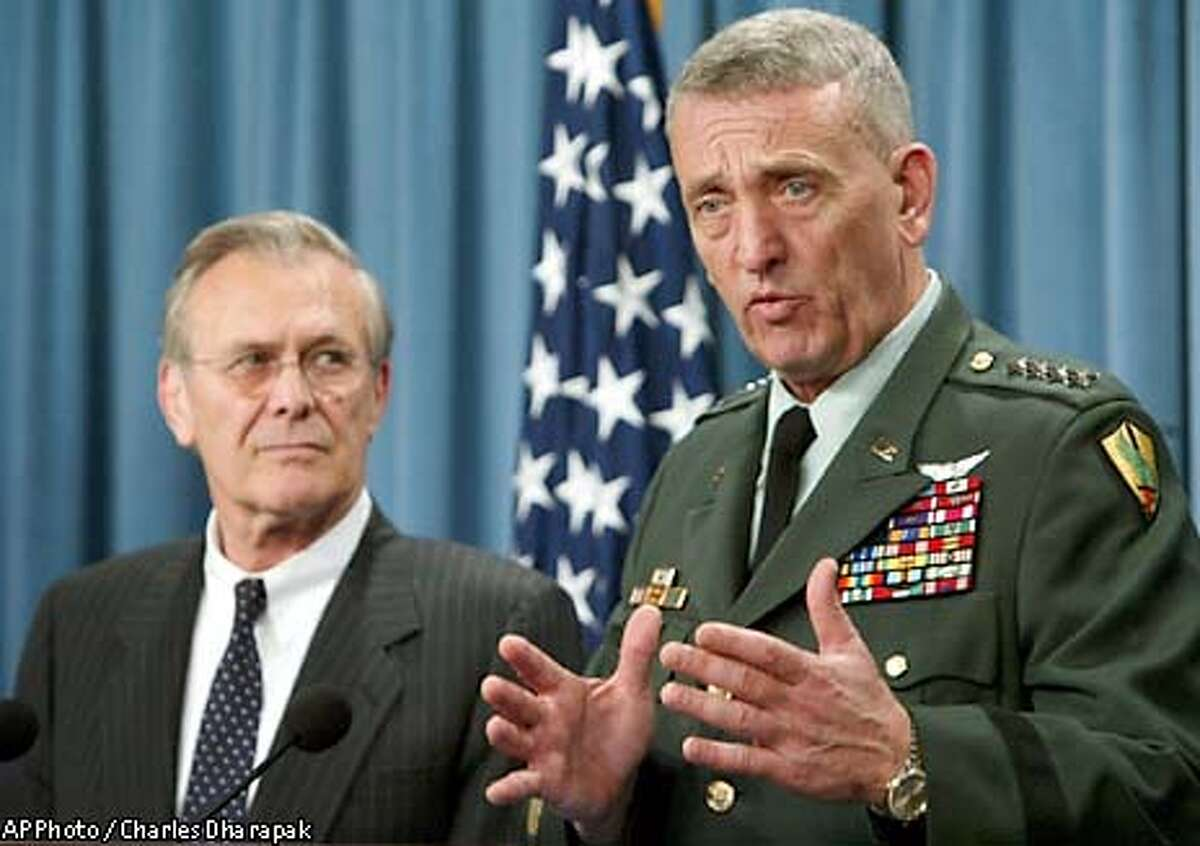 Gen. Tommy Franks, commander of the U.S. Central Command, right, gestures during a news conference as Secretary of Defense Donald Rumsfeld looks on at the Pentagon in Washington Friday, May 9, 2003. Rumsfeld said Friday it is not possible to know how long U.S. forces will have to remain in Iraq and suggested that stabilizing the newly liberated country could take longer than a year. (AP Photo/Charles Dharapak)