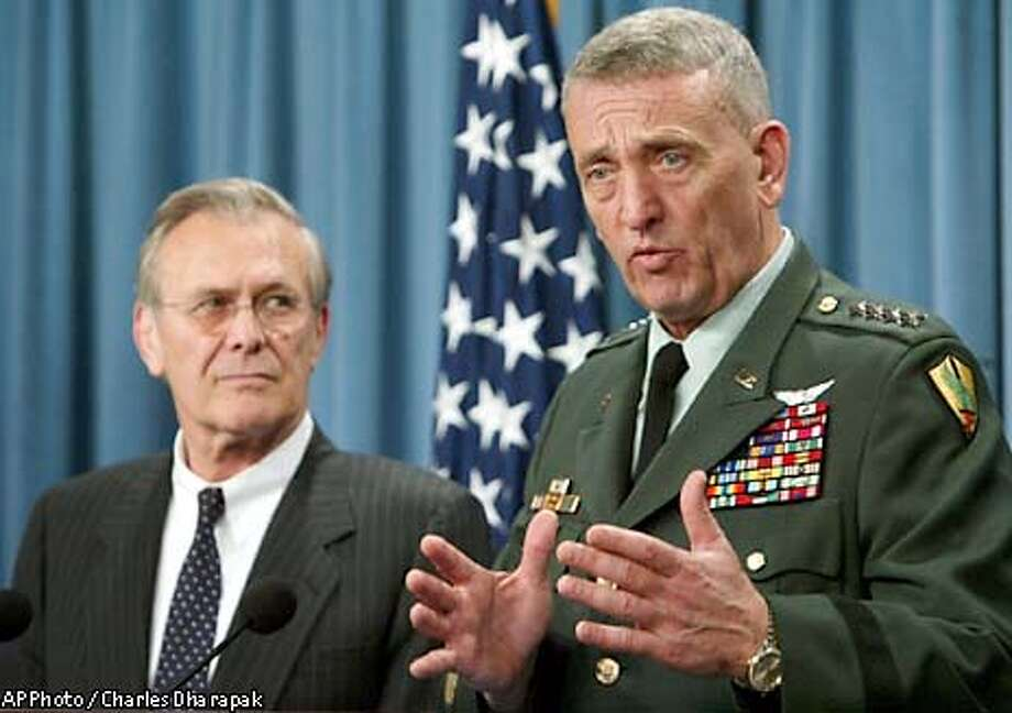 Gen. Tommy Franks, commander of the U.S. Central Command, right, gestures during a news conference as Secretary of Defense Donald Rumsfeld looks on at the Pentagon in Washington Friday, May 9, 2003. Rumsfeld said Friday it is not possible to know how long U.S. forces will have to remain in Iraq and suggested that stabilizing the newly liberated country could take longer than a year. (AP Photo/Charles Dharapak) Photo: CHARLES DHARAPAK