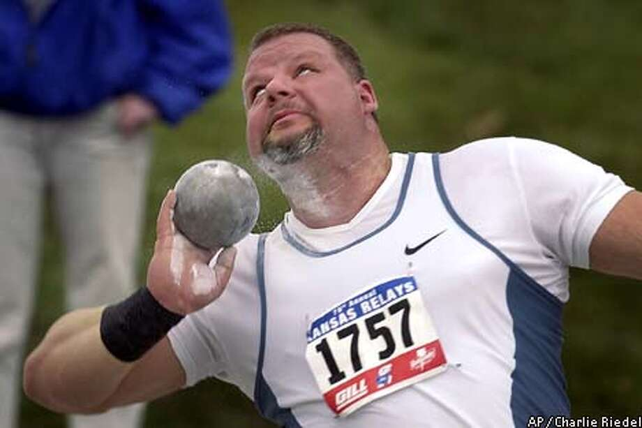 Kevin Toth releases the shot during the in Lawrence, Kan. Saturday, April 19, 2003. Toth set a personal best and a meet record with a throw of 74-4 1/2. (AP Photo/Charlie Riedel) Photo: CHARLIE RIEDEL