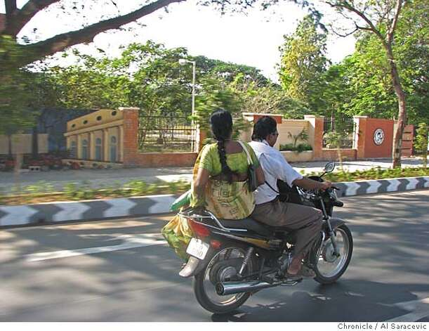 Morning commuter rides sidesaddle through the streets of Chennai, India. Source: Chronicle/Al Saracevic Photo: Chronicle/Al Saracevic