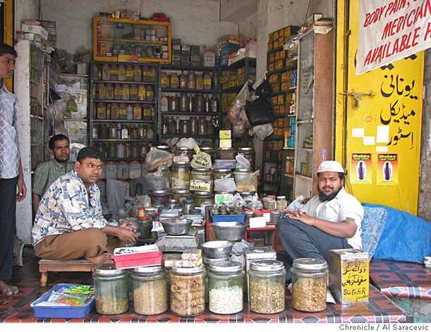 Shopkeepers in Hyderabad. Photo by Al Saracevic  Ran on: 02-07-2007  These shopkeepers in Hyderabad didn't take a formal position on the central bank's &quo;timid&quo; quarter-point interest rate increase. Photo: Al Saracevic