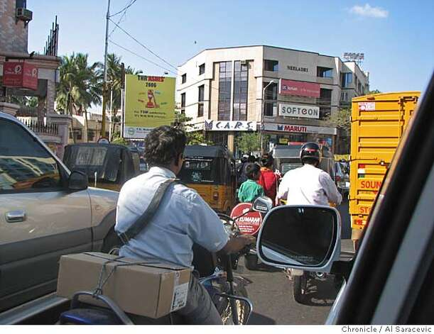 Indian cities are overrun with traffic, as evidenced by this rush hour shot from Chennai Credit: Al Saracevic/The Chronicle  Ran on: 02-08-2007  Indian cities are overrun with traffic, as evidenced by this rush hour shot from Chennai, a bustling city once known as Madras. Photo: Al Saracevic/The Chronicle