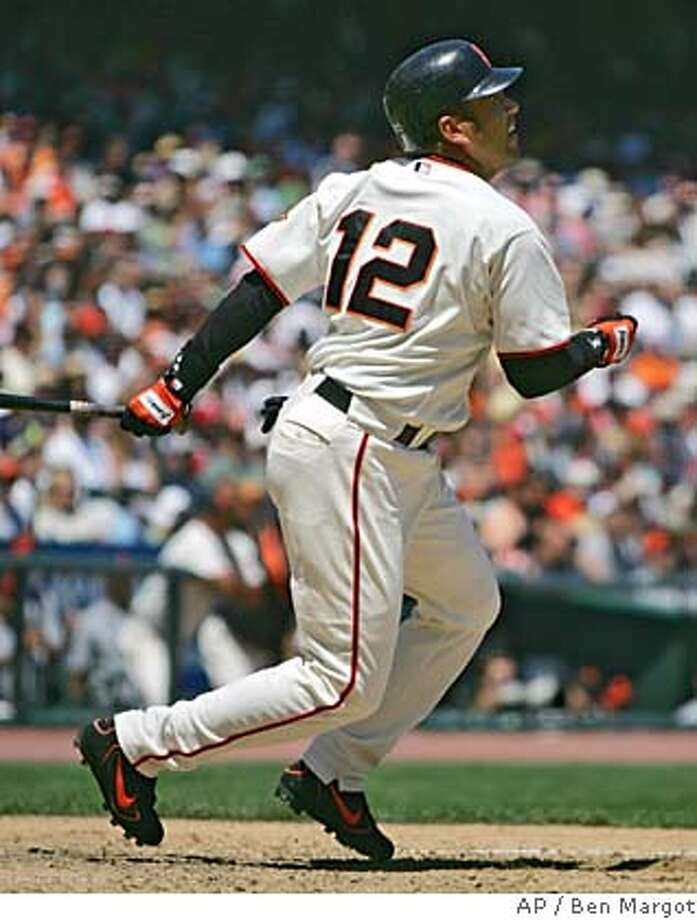 San Francisco Giants' Edgardo Alfonzo swings for an RBI single off Houston Astros' Roy Oswalt during the third inning Saturday, Aug. 6, 2005, in San Francisco. The Giants won 5-2. (AP Photo/Ben Margot) Photo: BEN MARGOT