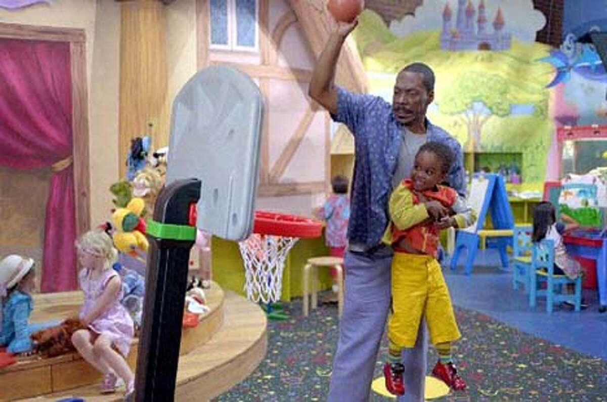 Charlie Hinton (Eddie Murphy) and his son Ben (Khamani Griffin of Oakland) take it to the hoop in