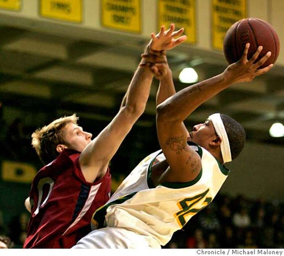 LMU Lions' Mason Maynard (50) tries to block USF Dons' Johnny Dukes (42) shot in the 1st period.  The University of San Francisco men's basketball team hosts Loyola Marymount at Memorial Gymnasium on the USF campus in San Francisco, CA on Monday, February 12, 2007. Photo by Michael Maloney / San Francisco Chronicle Photo: Michael Maloney
