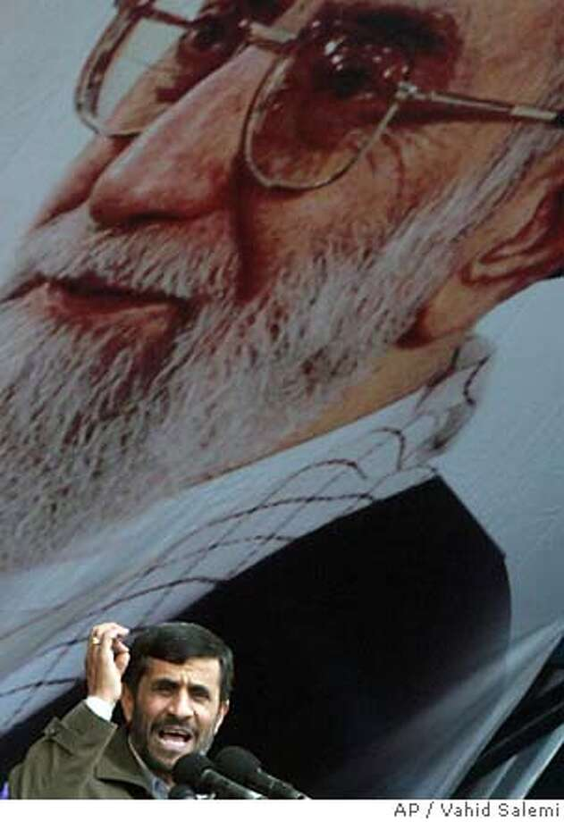 Beneath a picture of the Iranian supreme leader Ayatollah Ali Khamenei, President Mahmoud Ahmadinejad delivers a speech during a rally marking the 28th anniversary of the 1979 Islamic Revolution, at the Azadi (Freedom) Sq. in Tehran, Iran, Sunday, Feb. 11, 2007. Ahmadinejad struck a defiant, yet vague tone on Sunday, telling Iranians during the 28th anniversary of the Islamic Revolution that their country would not give up uranium enrichment but was prepared to talk with the international community. (AP Photo/Vahid Salemi) Photo: VAHID SALEMI