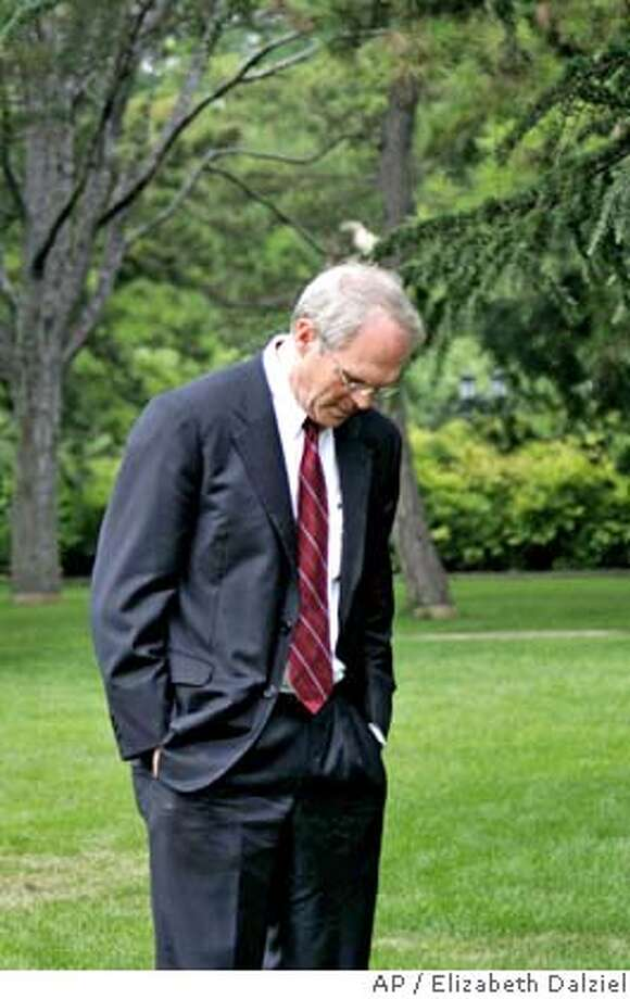 U.S. Assistant Secretary of State Christopher Hill strolls in the Diayoutai compound gardens while Chinese Vice Foreign Minister Wu Dawei, not in picture, speaks to the media after all the six parties to the fourth round of the Korean nuclear issue talks agreed to take a recess in Beijing Sunday Aug. 7, 2005. Wu said at the press conference following a chief delegates' meeting that the general goal of the six-nation talks is to achieve the denuclearization of the Korean Peninsula in a peaceful manner. (AP Photo/Elizabeth Dalziel/POOL) POOL Photo: ELIZABETH DALZIEL