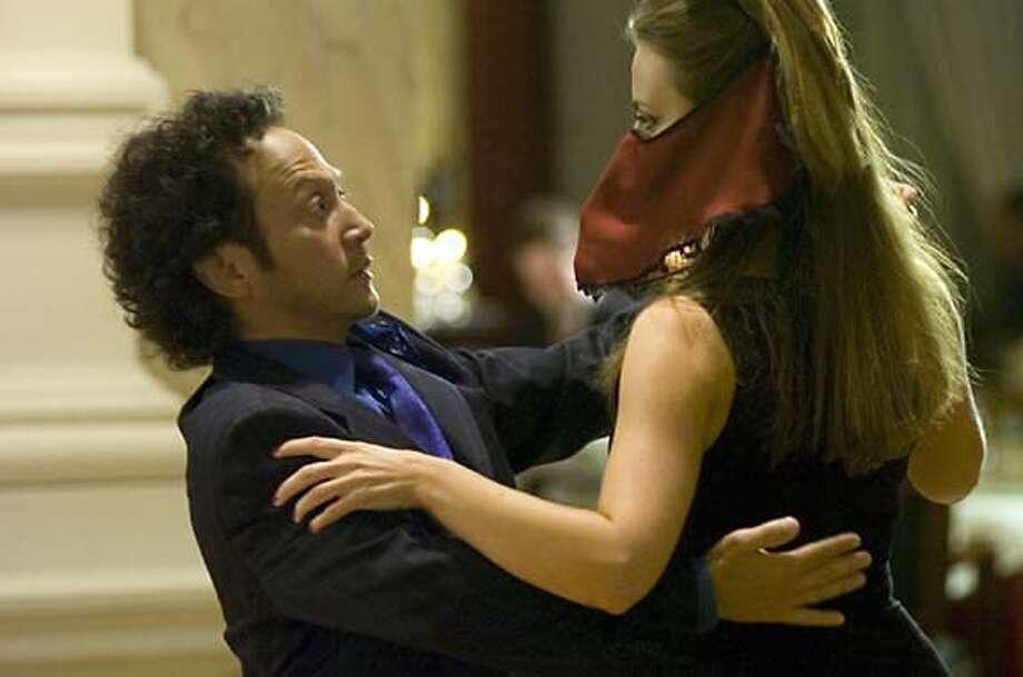 Rob Schneider (l) and Miranda Raison star in Columbia Pictures' comedy Deuce Bigalow: European Gigolo. Photo: Dinand Van Der Wal