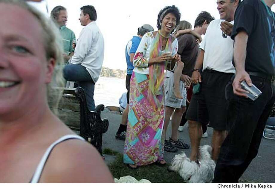 onlocationSaus252_mk.jpg  On Location Sausalito - Amore laughs with the crowd in a flowy colorful frock from southern Mexico. 7/21/05 Mike Kepka / The Chronicle MANDATORY CREDIT FOR PHOTOG AND SF CHRONICLE/ -MAGS OUT Photo: Mike Kepka